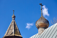 Two Wooden Dome With Orthodox Cross Of Church Of The Beheading Of St. John The Baptist In European City Grodno Or Hrodna Belarus On Blue Sky Background With Cirrus Clouds With Copyspace.