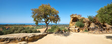 Ruins Of Ancient Protective Wall Of Akragas Town.Valley Of Temples, Agrigento, Sicily Island In South Italy. Panoramic Image With Single Tree.