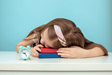 A Young Girl Fell Asleep At School At Her Desk. Oversleep, Not Get Enough Sleep.