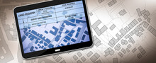 Land Registry Concept Image With An Imaginary Cadastral Map Of Territory - Property Tax On Buildings With Land And Buildings Cadastre With Land Registry Document On A Digital Tablet - 3D Rendering