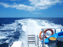 Sea Voyage, View From The Stern Of A Motor Yacht To The Sea. Horizon, Open Ocean, Panorama, Seascape. Wake Jet. Ship's Wake. Trace Of Sea Foam On A Water Behind A Sailing Vessel. Speed Boat. Cruise