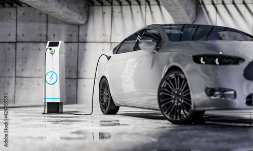 Obraz Charging an electric car with a public charger in a parking lot - fototapety do salonu