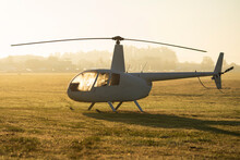 A Light Helicopter On A Grass Landing Area