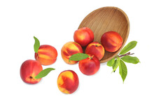 Scattered Nectarines From Wooden Bowl With Leaves Isolated On White Background