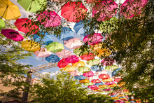 Colorful Floating Umbrellas Hang Above The Street. Umbrella Sky Project In Coral Gables, Miami, Florida