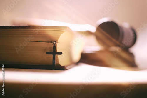 Fototapeta the sacred bible, crucifixion, the judge's hammer as the concept of the Supreme