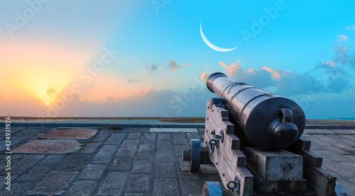 Ramadan Concept - Ramadan kareem cannon with crescent - Night sky with moon in t Fototapet
