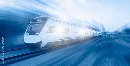 Obraz na plátně High speed train runs on rail tracks - Train in motion