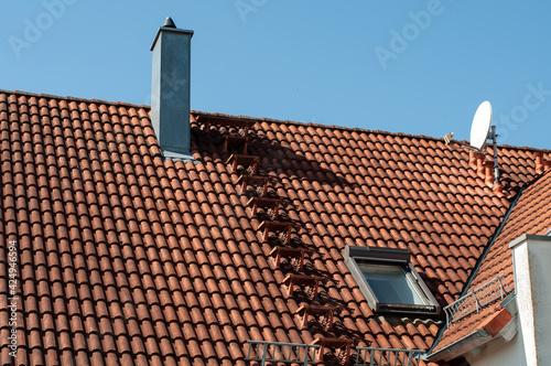 Obraz na plátně the roof of a building with steps to chimney