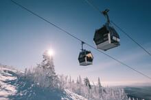 Gondola Ski Lift In Mountain Ski Resort, Winter Day, Snowy Spruce Forest