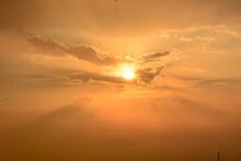 The Magnificent Sun Shining Through The Clouds