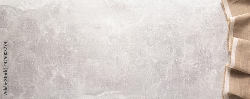 Billede på lærred Folded tablecloth at stone or marble surface of table