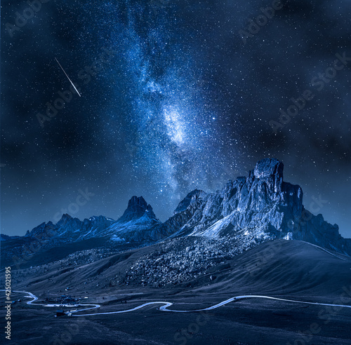 Milky way over Passo Giau, Dolomites. Mountain hiking at night.