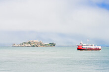 Alcatraz Island And A Tourist Ferry Boat In A Foggy San Francisco Day - San Francisco, United States