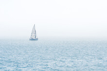 Sailboat On The Sea In An Foggy Day