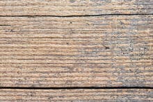 Old Sandy Weathered Washed Tainted Wood Texture With Horizontal Cracks And Grains Of River Sand. Natural Textured Closeup Dry Plank Background.