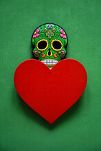 Colorful Skull On Green Background. Halloween Photo, Image With Colorful Mexican Skull And Red Heart. Heartbreaker Idea, Sign, Symbol, Concept. Happy Valentines Day