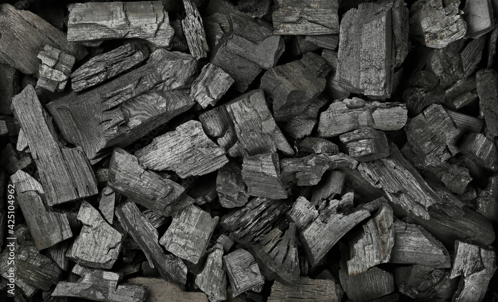 Fototapeta Background texture of many black charcoal pieces
