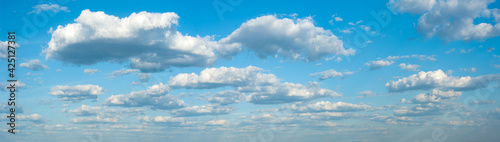 Fototapeta panorama of clouds against the blue sky. Background, wallpaper. Gradient transition from dark to light. Weather forecast screensaver, website, banner. obraz