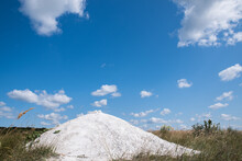Chalky Hill On A Background Of Blue Cloudy Sky.