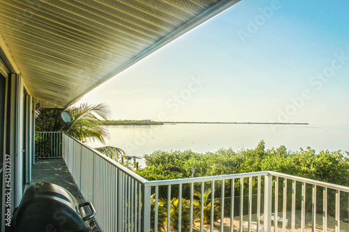 Photo Looking out over tropical  ocean from balcony of vacation rental over private be