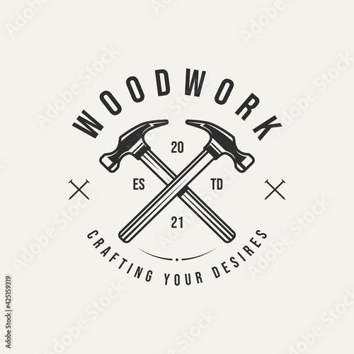 Fotografie, Obraz woodwork hammer carpentry vintage badge logo template vector illustration design