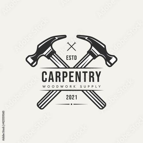 Fototapeta cross hammer carpentry vintage logo template vector illustration design