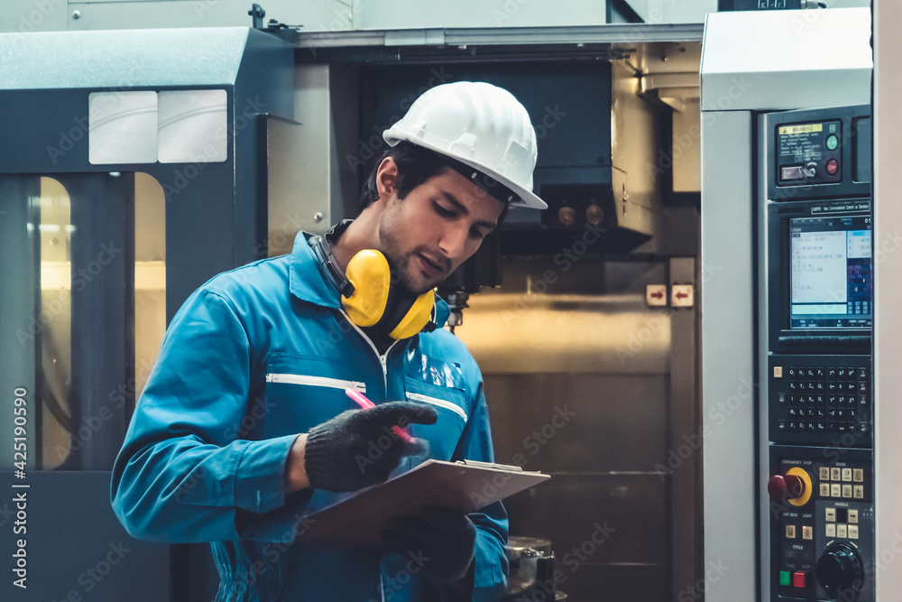 Fototapeta Smart factory worker or engineer do machine job in manufacturing workshop . Industry and engineering concept .