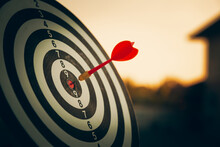 Bullseye Target Or Dart Board Has Red Dart Arrow Throw Hitting The Center Of A Shooting For Business Targeting And Winning Goals Business Concepts.