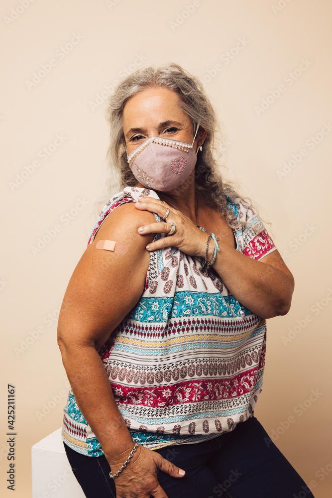 Fototapeta Senior woman getting a covid vaccine