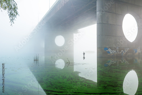 Fototapeta bridge over foggy river