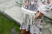Boho Girl In Multicolored Dress With Fringed Waist Bag. White Fringe Purse Fashion Belt Bag Women Leather Fanny Pack