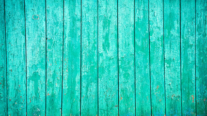 Aged blue planks with peeled paint. Blue background. Close-up. Copy space. Defocus.