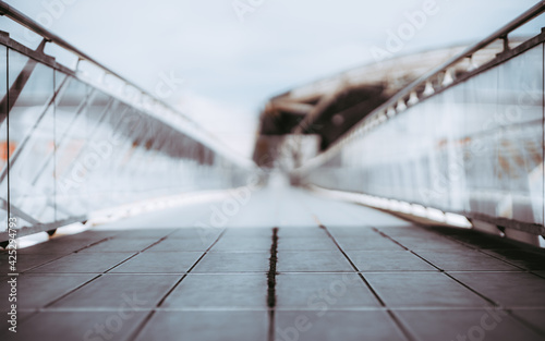 View of a long bright overhead passage or a pedestrian bridge stretching into th Fototapeta