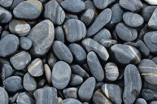 Fototapeta colorful black rock on beach from beauty stone island travel location in Thailan