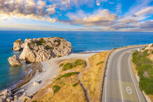 Nature Of Cyprus. Rock Aphrodite Next To  Sea. Highway On Mediterranean Coast. Road Leads To City Of Paphos. Bay Of Aphrodite In Cyprus. Landscape Of Petra-Tu-Romiou. Cyprus Island In Summer Day