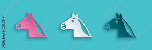 Fototapeta Paper cut Horse head icon isolated on blue background. Animal symbol. Paper art style. Vector obraz
