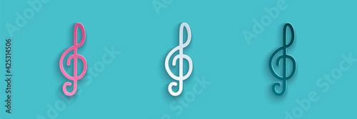 Fotografia Paper cut Treble clef icon isolated on blue background