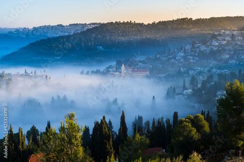 Fotografiet Beautiful view of morning cloud inversion in the Judean hills around Ein Karem n