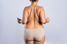 Overweight Woman With Fat Hips And Buttocks, Obesity Female Body On Gray Background