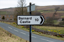 Barnard Castle Signpost.  Black And White  10 Miles Sign, Pointing Right. Arkengarthdale, Yorkshire Dales. UK. Horizontal.  Space For Copy.