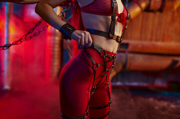 Sexy woman body in red bdsm suit chained up