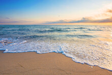 Summer Vacation At The Seaside. Beautiful Seascape At Sunrise. Calm Waves Wash The Golden Sandy Beach. Fluffy Clouds On The Sky