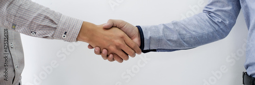 Businessman shaking hands successful making a deal. mans handshake. Business partnership meeting concept.