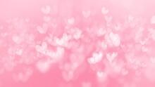 Pink Wallpaper Background With Beautiful Heart Shape Bokeh.