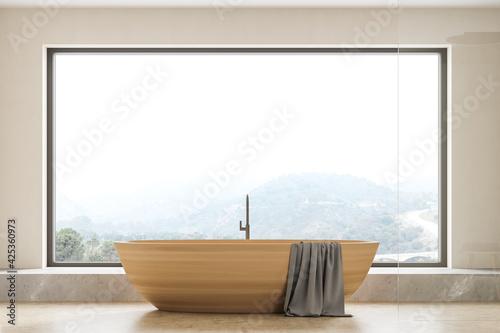 Canvas Beige bathroom interior with bathtub on concrete floor