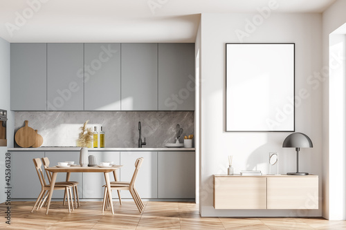 Obraz na plátně Bright cozy kitchen room interior with dining table and poster
