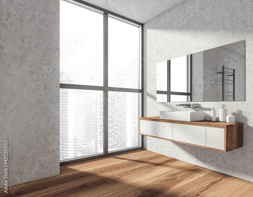 Obraz Bathroom interior with sink and mirror on grey wall near window - fototapety do salonu