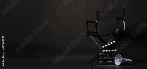 Fotografía Black director chair and Clapper board or movie Clapperboard with megaphone on black background
