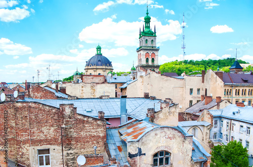 Old neighborhood in Lvov with bell tower and cupola of Dominican Church, Ukraine Poster Mural XXL